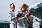 Leeds United forward Patrick Bamford (9) scores a goal and celebrates with Leeds United defender Ben White (5) and Leeds United midfielder Kalvin Phillips (23) to make the score 1-0 during the EFL Sky Bet Championship match between Leeds United and Blackburn Rovers at Elland Road, Leeds, England on 9 November 2019.
