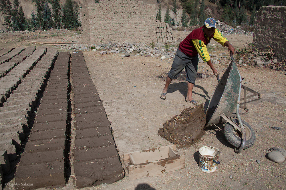 Man making clay bricks. People in the village of Sunchubamba, a Quechua speaking native community in Southeastern Peru that is running a reforestation plot in the Andes near Cusco and the Interoceanic Highway.