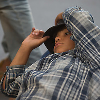 Illegal migrant boy lies on the platform as his family waits to board a train in hopes to leave for Germany at the main railway station Keleti in Budapest, Hungary on September 03, 2015. ATTILA VOLGYI