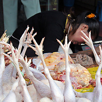 Asia, China, Chongqing. Chicken legs in local street market in the city of Chongqing.