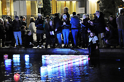 "People set afloat lanterns during a lantern ceremony given by the association ""ToujoursParis.fr"" at the Canal Saint-Martin in Paris, France, on November 13, 2016 to mark the first anniversary of the Paris terror attacks. 130 people were killed on November 13, 2015 by gunmen and suicide bombers from the Islamic State (IS) group in a series of coordinated attacks in and around Paris. Photo by Alain Apaydin/ABACAPRESS.COM"