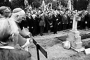 Taoiseach and Mrs Liam Cosgrave among the political and Church dignitaries at the graveside of Eamon de Valera as he is buried in Glasnevin cemetery. A founder of Fianna Fail, he served several terms as Taoiseach, then became the third President of Ireland in 1959, re-elected in 1966. At his retirement in 1973 at the age of 90, he was the oldest head of state in the world.<br /> 31/08/1975