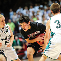 031413  Adron Gardner/Independent<br /> <br /> Shiprock Chieftain Justin Begay (20) drives past Hope Christian Huskies Micah Murphy (15), left,  and Austen Drake (34) during the 3A New Mexico High School Basketball tournament semifinals at The Pit in Albuquerque Friday.