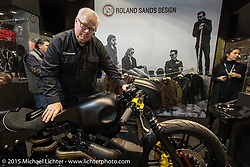 Ted Sands with a bike showing off RSD accessories in the MAG booth at EICMA, the largest international motorcycle exhibition in the world. Milan, Italy. November 18, 2015.  Photography ©2015 Michael Lichter.