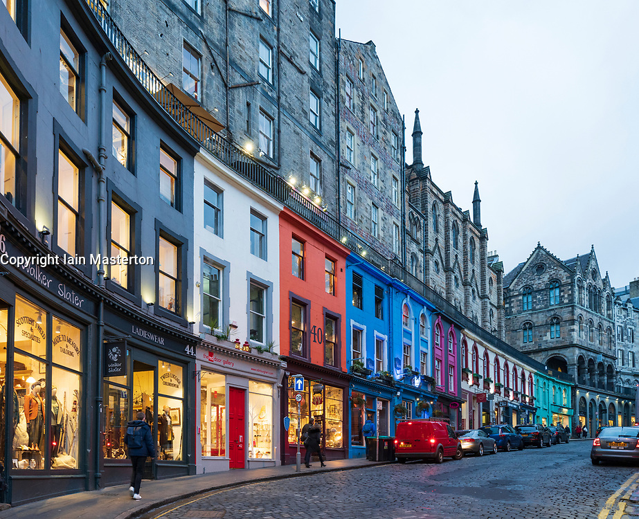 Dusk view of historic buildings and shops on Victoria Street in Edinburgh Old town, Scotland, UK