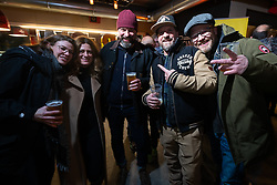 Ela Von Dutch, BMW's Roland Stocker and Rokker's Michael Kuratli and Kai Glatt at the Mr. Martini's Cafe and Restaurant party during Motor Bike Expo (MBE) bike show. Verona, Italy. Saturday, January 18, 2020. Photography ©2020 Michael Lichter.