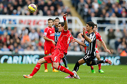 Dejan Lovren of Liverpool is challenged by Ayoze Perez of Newcastle United - Photo mandatory by-line: Rogan Thomson/JMP - 07966 386802 -01/11/2014 - SPORT - FOOTBALL - Newcastle, England - St James' Park - Newcastle United v Liverpool - Barclays Premier League.