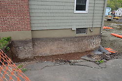 Winchester Avenue Neighborhood, Hamden, CT Remediation. Soil with contamination being removed 4 feet down, barrier positioned and new soil brought in.