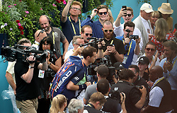 England's Andy Murray makes his way on to centre court during day two of the Fever-Tree Championship at the Queens Club, London.