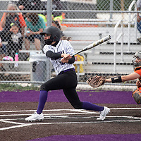 Miyamura Patriot Shelby Cordova watches the ball as she hits a grand slam in the bottom of the 5th inning giving Miyamura the lead against the Aztec Tigers Wednesday in Gallup.