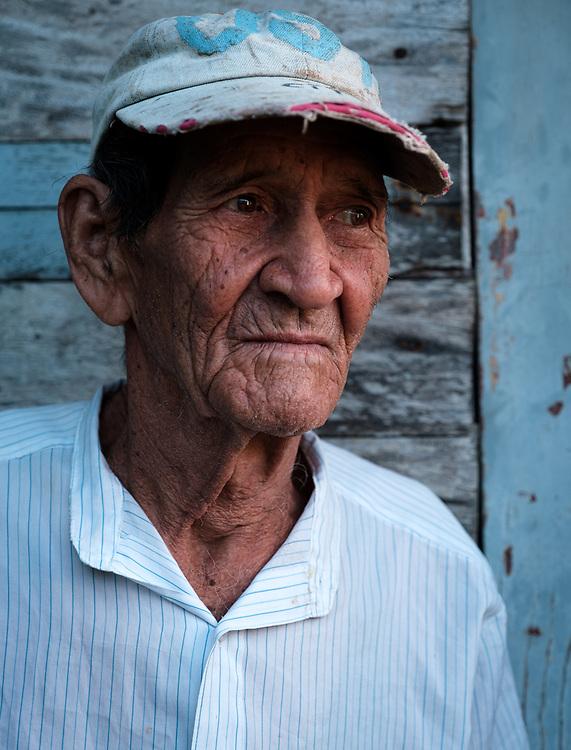 BARACOA, CUBA - CIRCA JANUARY 2020: Portrait of old man in Bahia de Mata, a hamlet close to Baracoa in Cuba.
