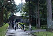 """The approach to a concrete building housing the Konjikido repository, Chusonji temple, Hiraizumi, Japan, 28 August 2008. The temple was founded in 850..Hiraizumi in Northern Japan flourished as the seat of the Oshu Fujiwara clan for around 100 years from the end of the 12th century. The city was built to be an earthly recreation of the Buddhist """"Pure Land"""" or Nirvana."""
