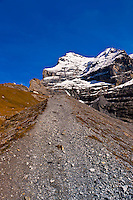 Hiking in the Swiss Alps from Eigergletscher down to Wengernalp, Kleine Scheidegg, Canton Bern, Switzerland