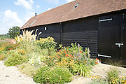 The barn with gardens at Hares Farm CREDIT: Vanessa Berberian for The Wall Street Journal<br /> UKFARM-Hares Farm