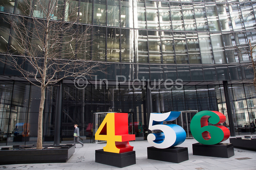 'One Through Zero (The Ten Numbers)' by American pop artist Robert Indiana (b 1928), in Lime Street, City of London, UK. These large scale number sculptures interract with City workers in the financial district of the capital.