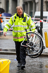 © Licensed to London News Pictures. 22/06/2015. London, UK. Bicycle of a female cyclist who died in a crash with a tipper truck at Bank junction is being taken away by police officers in London during morning rush hour on Monday, June 22, 2015. Photo credit: Tolga Akmen/LNP