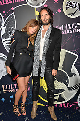RUSSELL BRAND and JEMIMA KHAN at The Hoping Foundation's 'Starry Starry Night' Benefit Evening For Palestinian Refugee Children held at The Cafe de Paris, Coventry Street, London on 19th June 2014.