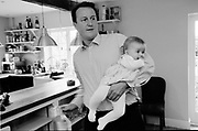 David Cameron, Conservative Party Leader and Conservative MP for Whitney, Oxfordshire, UK at home with his youngest child Arthur.