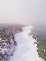 Aerial view of the snowy misty coast of Muraste in Estonia.