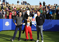 American captain Jim Furyk (left) and European captain Thomas Bjorn pose with Mickey Mouse during a media event ahead of the 2018 Ryder Cup at Le Golf National, Paris.