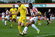 Anthony O'Connor attempts to block Craig Braham-Barrett's cross during the Sky Bet League 2 match between Cheltenham Town and Plymouth Argyle at Whaddon Road, Cheltenham, England on 28 March 2015. Photo by Alan Franklin.