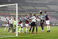 Football - 2020 /2021Premier League - West Ham United vs Fulham - The London Stadium<br /> <br /> Fulham's Ola Aina clears from a corner.<br /> <br /> COLORSPORT/ASHLEY WESTERN