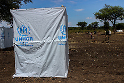 Sanitation is vital, and the UNHCR has set up many toilt facilities in order to contain disease, particurly cholera. More than 300,000 South Sudanese refugees have fled from the country's civil war into Uganda since fighting broke out in July. They mostly travel by foot for days through the bush as roads have been blocked or are too dangerous to cross. The massive influx of refugees has caused a strain in humanitarian aid due to large numbers and lack of funding. BidiBidi settlement is now the third largest in the world and holds more than 210,000 people since its opening in September.