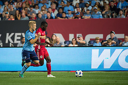 July 8, 2018 - Bronx, New York, United States - New York Red Bulls defender KEMAR LAWRENCE (92) fights for the ball against New York City defender ANTON TINNERHOLM (3) during a regular season match at Yankee Stadium in Bronx, NY.  New York City FC defeats the New York Red Bulls 1 to 0 (Credit Image: © Mark Smith via ZUMA Wire)