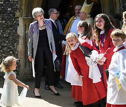 © Licensed to London News Pictures. 21/04/2019. Maidenhead, UK. British Prime Minister THERESA MAY and her husband PHILIP MAY are greeted by young members of the church choir as they leave an Easter Sunday church service in the Prime Minster's constituency. Photo credit: Ben Cawthra/LNP