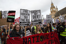 Thousands of students pass Parliament during a National Demonstration for a Free Education on 4th November 2015 in London, United Kingdom. The demonstration was organised by the National Campaign Against Fees and Cuts (NCAFC) in protest against tuition fees and the Government's plans to axe maintenance grants with effect from 2016.