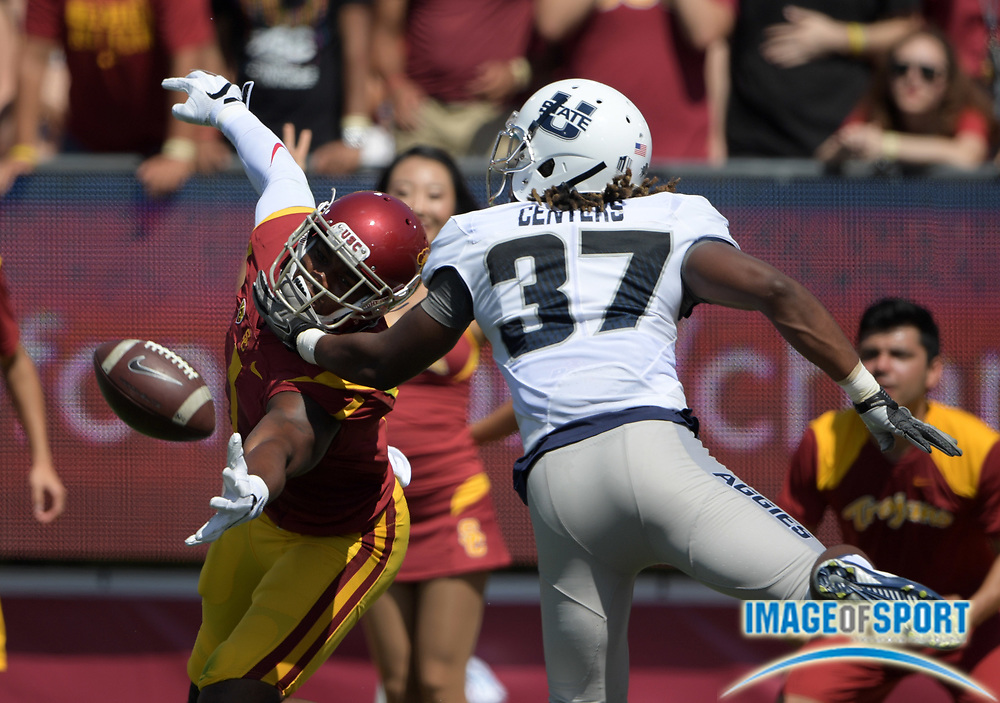 Sep 10, 2016; Los Angeles, CA, USA; USC Trojans wide receiver Darreus Rogers (1) is defended by Utah State Aggies safety Devin Centers (37) during a NCAA football game at Los Angeles Memorial Coliseum.
