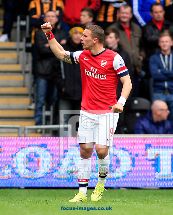 Lukas Podolski of Arsenal celebrates his goal  during the Barclays Premier League match at the KC Stadium, Kingston upon Hull<br /> Picture by Richard Gould/Focus Images Ltd +44 7855 403186<br /> 20/04/2014