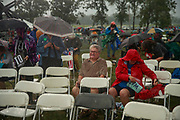 Democrats are soaked during by heavy rain while listening to candidates during the Polk County Steak Fry, Saturday, September 21, 2019 at Water Works Park in Des Moines, Iowa. The steak fry was the largest in Iowa's history and was attended by 12,000 Democrats from around Iowa. The event drew in 17 candidates for the democratic nomination for president of the United States. The Iowa Caucasus are Monday, February 3, 2020 and although not a primary will narrow down the field of candidates for president before the first election primary in the state of New Hampshire.