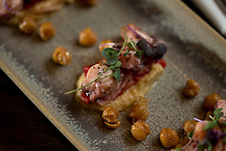 Detail of pulpo and garbanzo (octopus with chick peas) at La Marchas Tapas Bar, photographed Wednesday, Jan. 13, 2016, in Berkeley, Calif. (Photo by D. Ross Cameron)