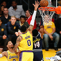 LOS ANGELES, CA - OCT 25: Gary Harris (14) of the Denver Nuggets goes for the reverse layup past Kyle Kuzma (0) of the Los Angeles Lakers during a game on October 25, 2018 at the Staples Center in Los Angeles, California.