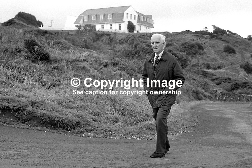 Rev Ray Davey, Presbyterian minister, N Ireland, UK, founder of the Corrymeela Community,  walking near the the peace & reconciliation organisation's headquarters near Ballycastle, Co Antrim. 197609260417RD2.<br /> <br /> Copyright Image from Victor Patterson, Belfast, UK<br /> <br /> t: +44 28 9066 1296 (from Rep of Ireland 048 9066 1296)<br /> m: +44 7802 353836<br /> e: victorpattersonbelfast@gmail.com<br /> <br /> www.images4media.com<br /> <br /> Please see my full Terms and Conditions of Use at https://www.images4media.com/p/terms-conditions - it is IMPORTANT that you familiarise yourself with them.<br /> <br /> Images used online incur an additional cost. This cost should be agreed in writing in advance. Online images must be visibly watermarked i.e. © Victor Patterson or that of the named photographer within the body of the image. The original metadata must not be deleted from images used online.<br /> <br /> This image is only available for the use of the download recipient i.e. television station, newspaper, magazine, book publisher, etc, and must not be passed on to a third party. It is also downloaded on condition that each and every usage is notified within 7 days to victorpattersonbelfast@gmail.com.<br /> <br /> The right of Victor Patterson (or the named photographer) to be identified as the author is asserted in accordance with The Copyright Designs And Patents Act (1988). All moral rights are asserted.