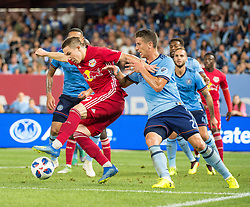 July 8, 2018 - Bronx, New York, United States - New York Red Bulls midfielder ALEX MUYL (19) fights for possession against New York City defender BEN SWEAT (2) during a regular season match at Yankee Stadium in Bronx, NY.  New York City FC defeats the New York Red Bulls 1 to 0 (Credit Image: © Mark Smith via ZUMA Wire)
