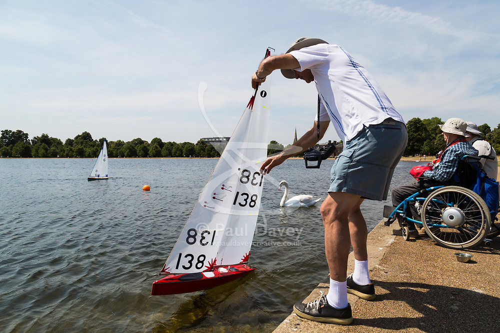 Model boat sailors enjoy the breeze on the pond in Kensington Gardens as another heatwave day begins with temperatures expected to soar. London, July 01 2018.