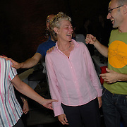 Thea Schwab, left, and Anita Jumelet, center, both of Amsterdam, The Netherlands, hug friends after they danced alone in their division of the senior women's standard event of the same-sex ballroom dancing competition during the 2007 Eurogames at the Waagnatie hangar in Antwerp, Belgium on July 13, 2007. ..It is the womens' first year competing in same-sex dance and the crowd gave them loud cheers. ..Over 3,000 LGBT athletes competed in 11 sports, including same-sex dance, during the 11th annual European gay sporting event. Same-sex ballroom is a growing sports that has been happening in Europe for over two decades.