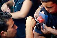 Boy getting a tattoo in Gibara, Holguin, Cuba.
