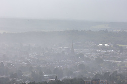 Licensed to London News Pictures. 30/07/2021. Dorking, UK. Gloomy views from Box Hill over Dorking in Surrey today as an unseasonable storm hit the South Coast today. Storm Evert hit the South Coast of England this morning with winds speed in excess of 65mph as the Met Office issue weather warnings for high winds, coastal gales and heavy rain with disruption to travel. Photo credit: Alex Lentati/LNP