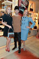 Left to right, AMBER ATHERTON, PIERS HARGREAVES-ADAMS and GRETA BELLAMACINA at the Roger Vivier 'The Perfect Pair' Frieze cocktail party celebrating Ambra Medda & 'Miss Viv' at the Roger Vivier Boutique, Sloane Street, London on 15th October 2014.