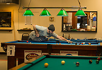 Dave Smith takes a shot during the 12th annual Robbie Mills 8-Ball Tournament at the Laconia Rod and Gun on Saturday.  (Karen Bobotas/for the Laconia Daily Sun)