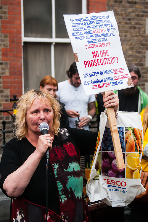 """Dublin, Ireland. 26th August, 2018. <br /> A mother of 2 children that died in the Madeleine Laundry, speaks crying at the end of the silent march of the Stand4Truth protest at the sites of previous laundries, in Sean Macdermott Street Lower, during the Holy Mass of the second of the two-days of the visit of Pope Francis in Dublin, Ireland.<br /> Pope Francis has made a two-day visit to the Republic of Ireland by celebrating a Mass at Dublin's Phoenix Park. The Argentine Pope asked forgiveness for the """"abuses in Ireland, abuses of power, conscience and sexual abuses"""" perpetrated by Church leaders. It was the first papal visit to Ireland for 39 years. During his activities many activists, victims and survivors have made protests and a silent march Garden of Remembrance towards the last Magdalene Laundry to close in Ireland.<br />  © Simone Padovani"""
