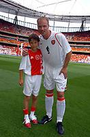Photo: Olly Greenwood.<br />Arsenal v Ajax. Dennis Bergkamp Testimonial. 22/07/2006.<br />Mascot Charlie Harris with Dennis Bergkamp.