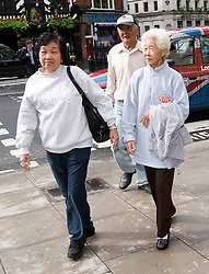 © London News Pictures. 08/05/2012. London, UK. L to R Chong Koon Ying, Loh Ah Choi and Lim Ah Yin , Family of Malaysians killed by British soldiers arriving at The High Court in London on May 08, 2012. The Family members of 24 villagers killed by UK troops  when Malaya was part of the British Empire are seeking an inquiry into their deaths which they claim were 'cold-blooded mass murder'. The judicial review is to be held on 8th and 9th of May. Photo credit: Ben Cawthra/LNP