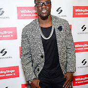 PHILADELPHIA, PA - DECEMBER 08:  Actor/Comedian Kevin Hart walks the red carpet at United Artists Riverview Cinema in Philadelphia, Pennsylvania to celebrate his upcoming new film Wedding Ringer on December 8, 2014 in Philadelphia City.  (Photo by Lisa Lake/Getty Images for Screen Gems/Sony)