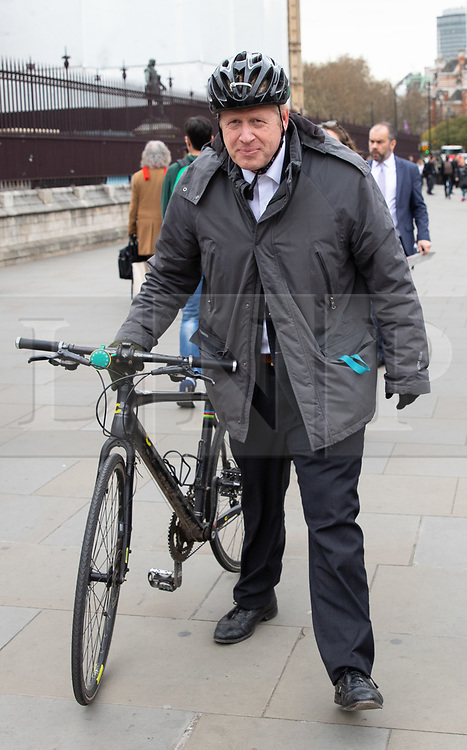 © Licensed to London News Pictures. 27/03/2019. London, UK. Boris Johnson MP arrives at the Houses of Parliament in Westminster this morning ahead of Prime Minister's Questions. Later today MPs are expected to vote on a series of indicative votes on alternative proposals to British Prime Minister Theresa May's withdrawal agreement. Photo credit : Tom Nicholson/LNP