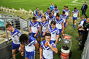 Dejected Bulldogs players exit the grounds.<br /> North Queensland Cowboys v Canterbury-Bankstown Bulldogs, Round 2 of the Telstra Premiership Rugby League season on Thursday 19th March 2020.<br /> Copyright photo: © NRL Photos 2020