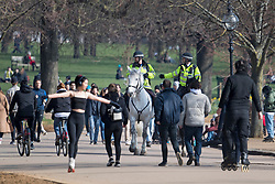 © Licensed to London News Pictures. 07/03/2021. London, UK. Police on horseback watch over as members of the public relax in Hyde Park central London on the last day of full lockdown. From tomorrow (Monday) some rules will be relaxed, including children returning to school. Photo credit: Ben Cawthra/LNP